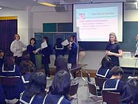 DEJ coleader Kristen McQuillin and member Heera Melrose-Woodman present the world of IT to Japanese middle-school girls.