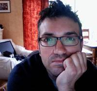 Paul Rose, who writes under the pseudonym Mr. Biffo, pictured on his webcam