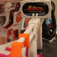laying around: The appBlaster gun accessory from Wiz Inc., which brings a new level of reality to iPhone gaming, and Happinet's virtual ping pong (below). | RICK MARTIN PHOTOS