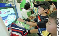 Kids play 'Mushiking' ('The King of Beetles') at Hakuhinkan Toy Park in Tokyo's Ginza district recently.