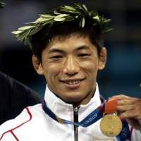 Guilty: Two-time Olympic gold medalist Masato Uchishiba takes the podium at the 2004 Athens Games. | KYODO