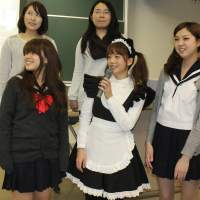 Local attraction: Five students from Nagoya City University wearing a variety of uniforms give a presentation on Japan's 'cosplay' culture during an English tour guide contest held at the university. | CHUNICHI SHIMBUN