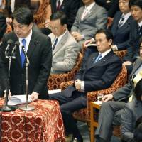 Tough talk: Defense Minister Itsunori Onodera responds to a question while Prime Minister Shinzo Abe (right), Finance Minister Taro Aso and other ministers look on Thursday during a Lower House Budget Commitee session.   KYODO