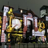 Swaying with the beat: Images of musical instruments are projected on the walls of JR Tokyo Station on Sept. 21 during a media preview of the commemoration celebrating the building's restoration. | KYODO