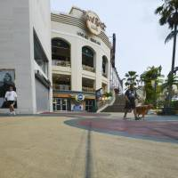 Chilling evidence: Tire marks from the car Chad Ryan De Soto drove into pedestrians Tuesday before hitting an ABC store in Guam's Tumon district can still be seen Thursday. | KYODO