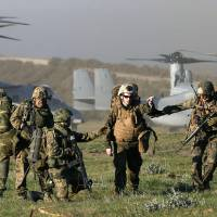 Landing zone: Ground Self-Defense Force troops and U.S. Marines stage a joint drill  Wednesday involving MV-22 Osprey tilt-rotor transports at Camp Pendleton in California. | KYODO