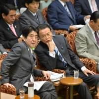 Comfort drink: Prime Minister Shinzo Abe's thermos bottle is within reach Tuesday during a House of Councilors Budget Committee session. | AFP-JIJI