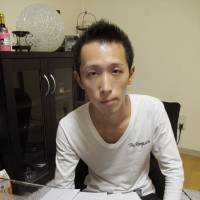Conflicted: Hiroto Oyama, whose father killed his mother, is interviewed last November at his home in Nagoya. | KYODO