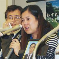 Redress plea : Vanessa Abordo Kanno, whose husband killed himself after the Fukushima nuclear disaster crushed his farming business, holds a news conference Wednesday in Tokyo. | KYODO