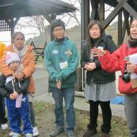 Crossing cultures: Mayumi Mukuno (right) organizes an exchange event in November between Japanese elementary school children in the disaster-hit coastal town of Yamada, Iwate Prefecture, and Southeast Asian youths who live in the area. | KYODO