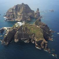 Between a rock: Shimane Prefecture on Friday held its annual Takeshima Day to mark its 1905 incorporation of the Takeshima islets. South Korea now has control of the territory, which it calls Dokdo. | KYODO