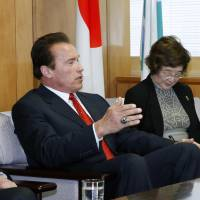 Energizer: Actor and former California Gov. Arnold Schwarzenegger gestures Friday while discussing global warming and energy issues with Environment Minister Nobuteru Ishihara at the latter's office.   KYODO