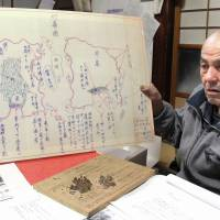 Keeping up the fight: Shoza Yawata, 84, shows materials he has collected regarding ownership of the islets called Takeshima by Japan and Dokdo by South Korea, in the town of Okinoshima, Shimane Prefecture, on Jan. 22.   KYODO