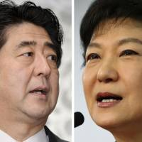 Friend or foe?: Prime Minister Shinzo Abe speaks to reporters in Naha, Okinawa Prefecture, on Feb. 2. Right: Park Geun Hye, who was sworn in as South Korea's president Monday, speaks during a Dec. 20 news conference. | KYODO, BLOOMBERG
