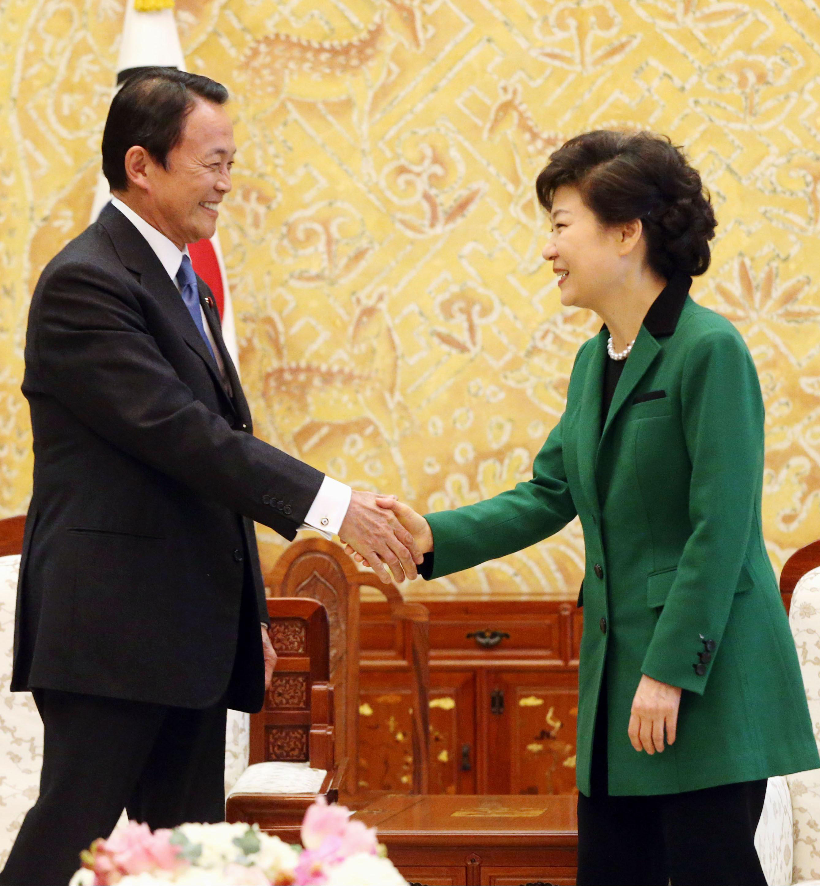 Tokyo seoul vow future oriented cooperation with history in mind staking positions deputy prime minister taro aso and south korean president park geun hye greet m4hsunfo