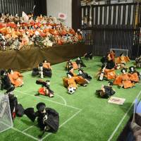 Visitors in Gujo, Gifu Prefecture, view a display of traditional Hina dolls playing soccer — part of an exhibition that kicked off Feb. 9 in hopes of breathing new life into the annual March 3 doll festival.  | KYODO PHOTO