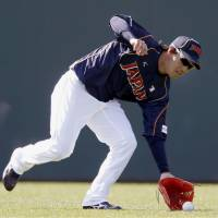 Ready for the world: Japan outfielder Hisayoshi Chono fields a ball during practice on Wednesday. | KYODO