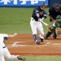 Big boost: Former major leaguer Kazuo Matsui strokes a two-out, bases-loaded triple in the fourth inning in Japan's 10-3 win over Australia on Sunday in Osaka. | KYODO