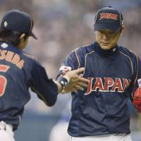 Quiet storm: Pitcher Tetsuya Utsumi (right) is determined to make an impact at next month's World Baseball Classic after making only one appearance at the 2009 edition. | KYODO