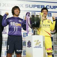 Back in action: Saturday's Xerox Super Cup gives Sanfrecce Hiroshima manager Hajime Moriyasu (far left) and his Kashiwa Reysol counterpart Nelsinho (far right) a chance to see their teams in action before the 2013 J. League  season officially begins.   KYODO