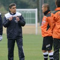 All change: Shimizu S-Pulse manager Afshin Ghotbi (left) leads a new-look squad into the new J. League season. | KYODO
