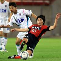 Young gun: Gaku Shibasaki (right) is likely to be a key player for Kashima Antlers over the coming J. League season.   KYODO