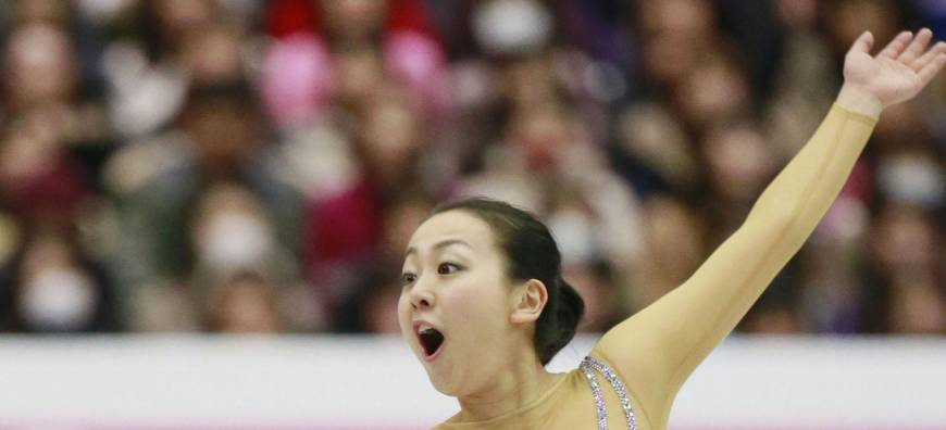 Mao executes triple axel to take lead; Reynolds wins men's title