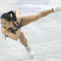 Solid start: Akiko Suzuki places second in the women's short program at the Four Continents on Saturday in Osaka. | KYODO
