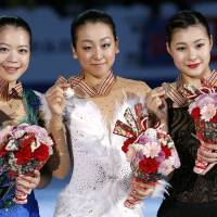 Clean sweep: (from left) Silver-medalist Akiko Suzuki, winner Mao Asada and bronze-medalist Kanako Murakami show their prizes at the Four Continents Figure Skating Championships in Osaka on Sunday. | AP