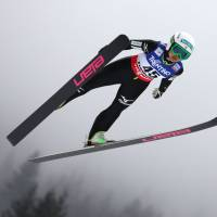 Preparation time: Ski jumper Sara Takanashi soars through the air during practice on Wednesday at the FIS World Nordic Ski Championships in Val di Fiemme, Italy. | AFP-JIJI