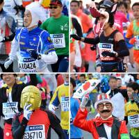 COS-RUNNING: Costumed runners take part in the Tokyo Marathon on Sunday. Around 36,000 people entered the event, which Kenyan Dennis Kimetto won in record time. | AFP-JIJI