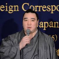Keep your head up: Yokozuna Harumafuji speaks during an event at the Foreign Correspondents' Club of Japan earlier this week. | AFP-JIJI