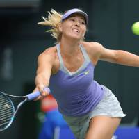 Healthy competition: Maria Sharapova is among 17 of the world's top 18 players taking part in the Qatar Total Open in Doha this week.   AFP-JIJI