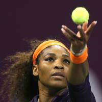 Not enough: Serena Williams, serving against Belarus star Victoria Azarenka, falls in three sets in the Qatar Total Open on Sunday. | AFP-JIJI