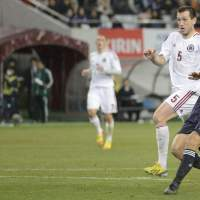 Keep your friends close: Keisuke Honda scores against Latvia during a friendly on Wednesday. | KYODO
