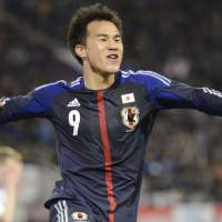 Off and running: Shinji Okazaki celebrates after scoring his second goal against Latvia during a friendly on Wednesday. Japan won 3-0. | KYODO