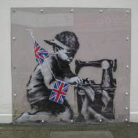 Priceless: This stencil by British artist Banksy appeared on the side of a north London bargain store last May. | AP
