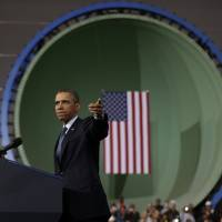 Land of the free: President Barack Obama speaks about automatic defense budget cuts in Newport News, Virginia, on Tuesday. | AP