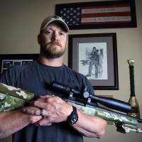 Lone gunman: Former U.S. Navy SEAL and 'American Sniper' author Chris Kyle poses in Midlothian, Texas, last April. | AP