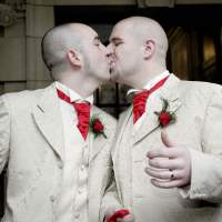 Sealed: Henry Edmont Cane (left) and Christopher Patrick Flanaghan kiss outside Belfast City Hall in December 2005. They were the first male couple to win legal recognition for their partnership under Britain's civil partnership law. | AP