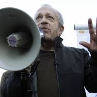 Fighting for the 99 percent: Former U.S. Secretary of Labor Robert Reich speaks to Occupy San Francisco demonstrators at Justin Herman Plaza on Oct. 19, 2011. Now teaching at the University of California, Berkeley, Reich blames anti-union legislation and market deregulation for the yawning chasm that has grown between America's wealthy and middle class since the late 1970s. | AP