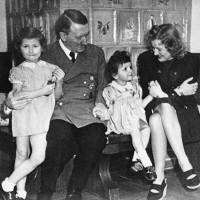 Family time: An undated photo of German Chancellor Adolf Hitler, his mistress Eva Braun and two girls were among the many items found in 1945 in a treasure chest belonging to Braun that give an intimate glimpse of the Nazi leader's private life. | AP