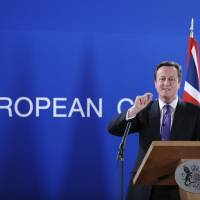 Budgetary player: British Prime Minister David Cameron speaks at a news conference Friday at the EU headquarters in Brussels. | AFP-JIJI
