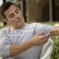 Angel of insemination: Massimiliano Gerina, who donated his sperm to a lesbian couple he was friends with around three years ago, displays a tattoo honoring his daughter, Ema, in Miami on Friday. | AP
