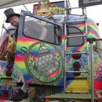 Hemp heaven: Zane Kesey emerges from the famous Merry Prankster bus that belonged to his late father, Ken Kesey, in August in Seattle. Kesey was attending the 21st annual Hempfest, a gathering on the Seattle waterfront billed as the 'World's Largest Profestival' to educate about marijuana and hemp products. | AP