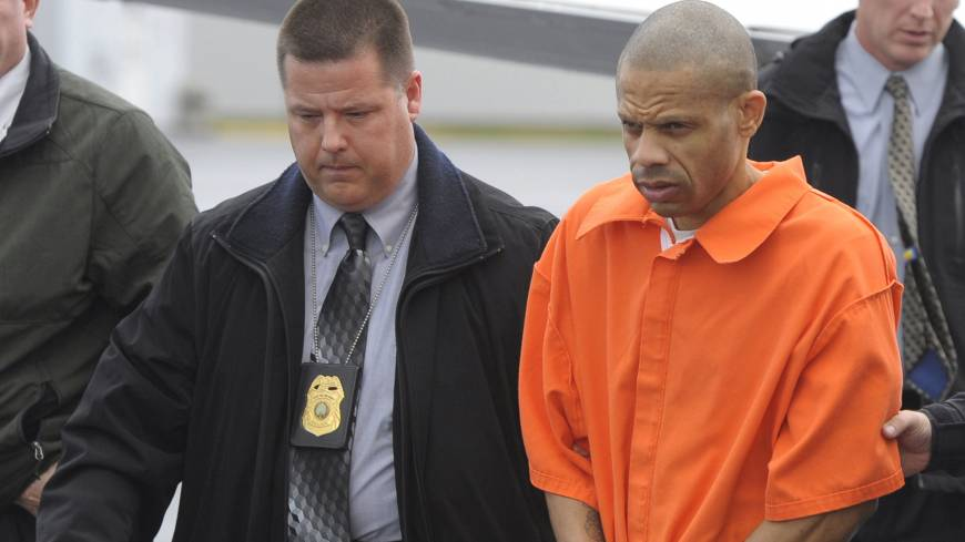 Serial rapist: Convicted rapist Aaron Thomas arrives in handcuffs at an airport in Manassas, Virginia, on Nov. 29, 2011.