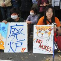 Long goodbye: Antinuclear protesters rally outside the Diet building Sunday in Tokyo, on the eve of the second anniversary of the March 11, 2011, quake and tsunami that triggered one of the worst nuclear catastrophes the world has seen.  | YOSHIAKI MIURA