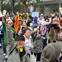 Long goodbye: Antinuclear protesters rally outside the Diet building Sunday in Tokyo, on the eve of the second anniversary of the March 11, 2011, quake and tsunami that triggered one of the worst nuclear catastrophes the world has seen.