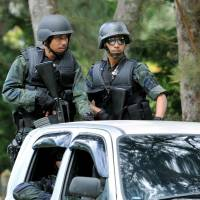 Malaysia threatens drastic action in Borneo isle siege