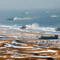 Storming the beach: North Korean forces conduct landing and antilanding drills Monday at an undisclosed location on the country's eastern coast. | AFP-JIJI